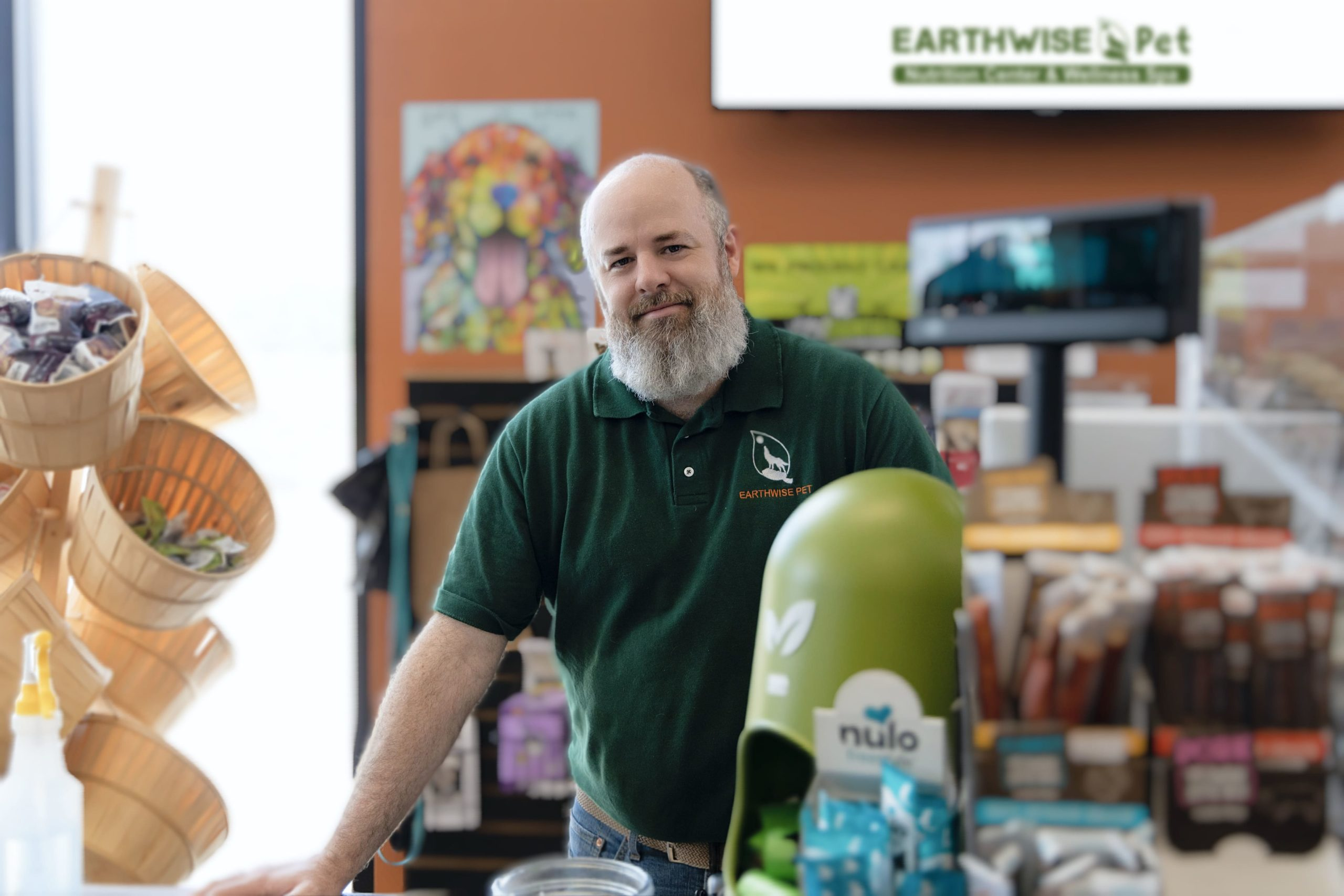 EarthWise Pet Franchisee Smiling at the Store Counter